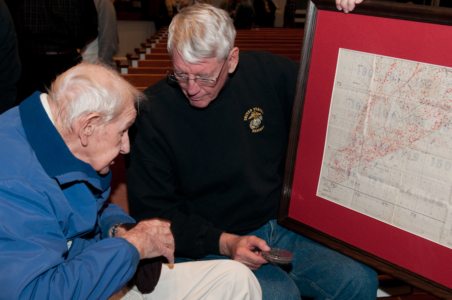 A Vietnam era Marine shares mementos from Iwo Jima with another, who fought there during WWII.